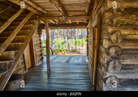 Breezeway of 1800s log cabin in Florida - Stock Photo