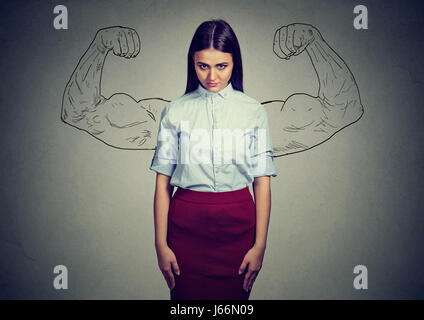 powerful girl reality vs ambition wishful thinking concept. Sad woman looking at camera isolated on gray wall background - Stock Photo