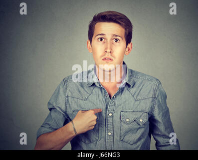 guy pointing at himself you mean me? - Stock Photo