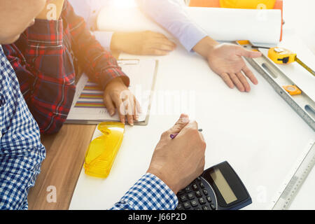 Image of engineer meeting for architectural project. working with partner and engineering tools on workplace. Engineer, - Stock Photo