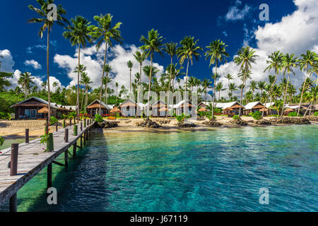 Amazing tropical beach with with coconut palm trees and villas on Samoa Island - Stock Photo