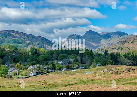 The Langdale Pikes seen from above Elterwater Lake District - Stock Photo
