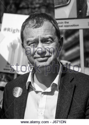 25 March 2017 - London, UK.  Black and white portrait of Tim Farron, leader of the UK Liberal Democrat party, against - Stock Photo