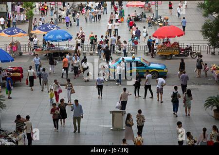 pedestrians and traffic, Yinchuan, Ningxia, China - Stock Photo