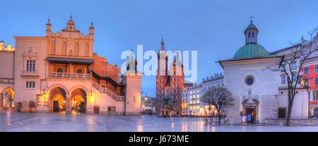 Cloth Hall, St. Mary's Basilica St. Adalberts Church on the Rynek at dusk, UNESCO World Heritage Site, Krakow, Lesser - Stock Photo