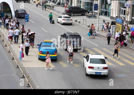 Pedestrians and traffic at Bus Rapid Transit station, Yinchuan, Ningxia, China - Stock Photo