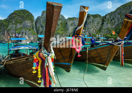 Boats at Phi Phi island in Thailand - Stock Photo