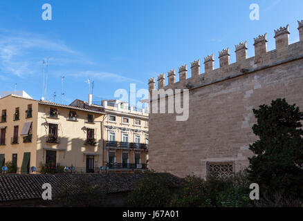 Wall of Silk Exchange and houses. Valencia, Spain - Stock Photo