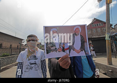 India. 19th May, 2017. Protesters display pictures of Osama Bin Laden and Aiman Al-Zawahiri during a demonstration - Stock Photo