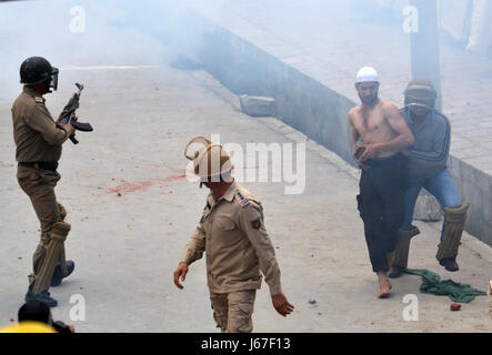India. 19th May, 2017. Indian policemen detain a youth during clashes in Srinagar the summer capital of Indian controlled - Stock Photo