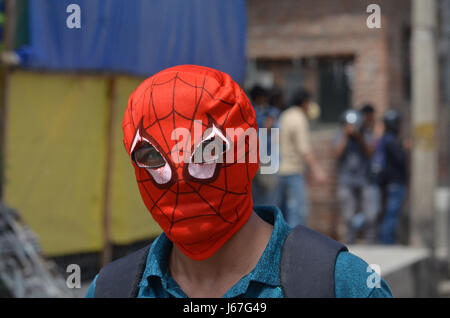 India. 19th May, 2017. A protester walks to join the protest in Srinagar the summer capital of Indian controlled - Stock Photo