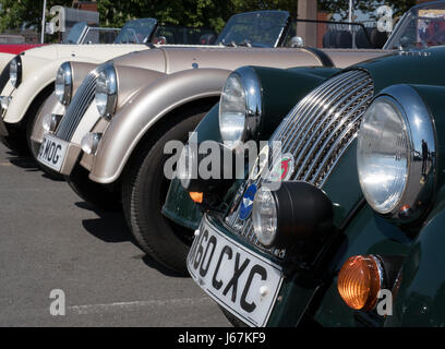 Morgan sports cars parked in the employee parking lot at the Malvern, England Morgan Motor Co. factory. - Stock Photo