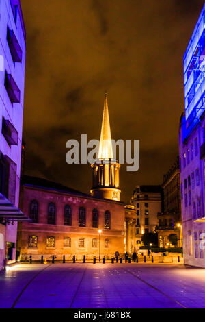All Souls' Church, Langham Place, London, UK, at night, illuminated in orange, the blue light from BBC Broadcasting - Stock Photo
