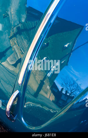 Abstract close up of reflections on the bonnet of a shiny blue-green Volkswagon Beetle car, London, UK - Stock Photo