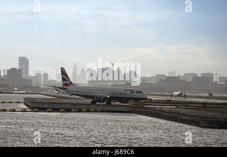 British Airways airplane on runway at London City Airport - Stock Photo