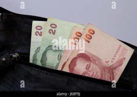 Thai baht cash in a shopping bag. - Stock Photo