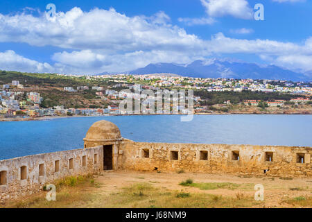 View of resort Greek architecture Rethymno city-port, built by Venetians, from height of Fortezza Castle - fortress - Stock Photo