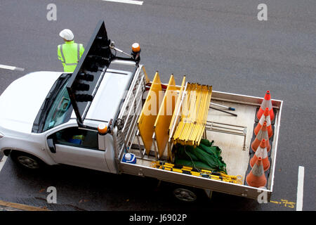 construction vehicle on a road, Newcastle, Australia - Stock Photo