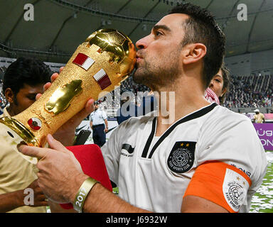Doha, Qatar. 19th May, 2017. Xavi of Al-Sadd kisses the trophy after winning the Qatar Emir Cup Final soccer match - Stock Photo