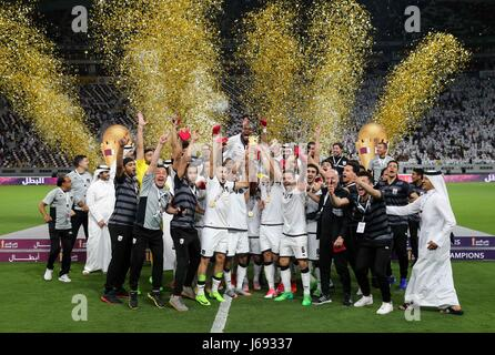 Doha, Qatar. 19th May, 2017. Members of Al-Sadd celebrate their victory in the Qatar Emir Cup Final soccer match - Stock Photo