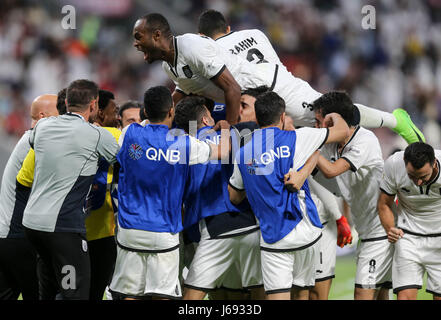 Doha, Qatar. 19th May, 2017. Players of Al-Sadd celebrate after winning the Qatar Emir Cup Final soccer match between - Stock Photo