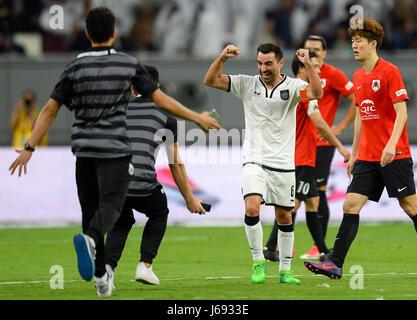 Doha, Qatar. 19th May, 2017. Xavi (3rd, L) of Al-Sadd celebrates with his teammates after winning the Qatar Emir - Stock Photo