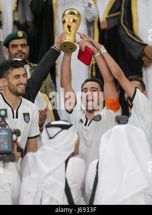 Doha, Qatar. 19th May, 2017. Xavi (C) of Al-Sadd celebrates with his teammates after winning the Qatar Emir Cup - Stock Photo