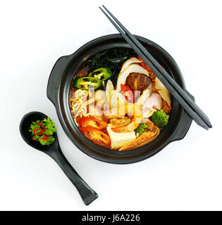 Hot chili ramen noodle with seafood in black stew - Stock Photo