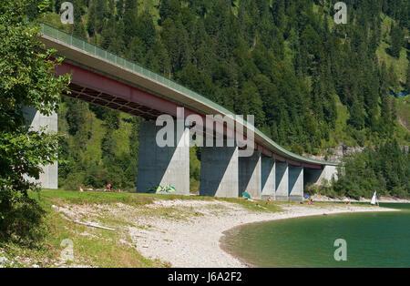 bridge on sylvensteinspeicher in bavaria - Stock Photo