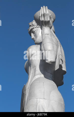 Kartvlis Deda This aluminium statue of a woman in traditional Georgian attire with a bowl of wine in one hand and - Stock Photo