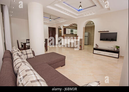 Living room lounge in luxury apartment show home showing interior design decor furnishing - Stock Photo