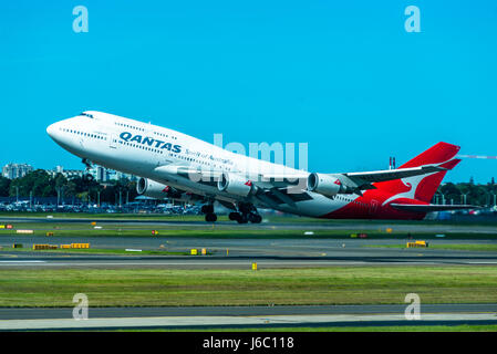 A Qantas jumbo jet taking off from Sydney Airport. New South Wales, Australia. - Stock Photo