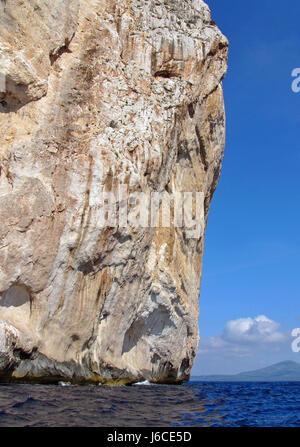 rock steep vertical high pressure area sardinia headland worms eye hill - Stock Photo