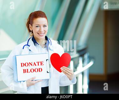 Closeup portrait happy smiling female health care professional woman doctor, transfusion medicine specialist holding - Stock Photo