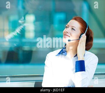 Closeup portrait young happy successful business woman, customer service representative, call centre worker, operator, - Stock Photo