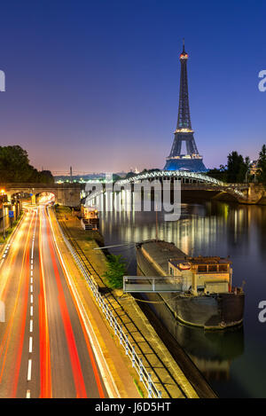 The Eiffel Tower, Rouelle Bridge and the Seine River at dawn. Paris, France - Stock Photo