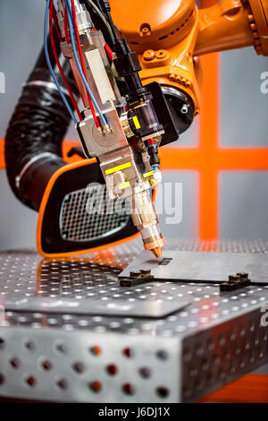Fibre laser robotic remote cutting system. CNC Laser plasma cutting of metal, modern industrial technology. - Stock Photo