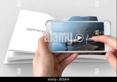 Augmented reality marketing concept. Hand holding smart phone use AR application to play video for customer. - Stock Photo