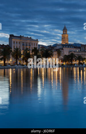 Waterfront of town Split in blue dawn; Dalmatia, Croatia - Stock Photo