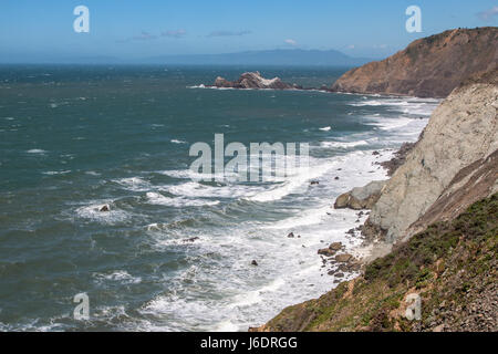 View of Ocean Waves Crashing against the Cliffs - Stock Photo