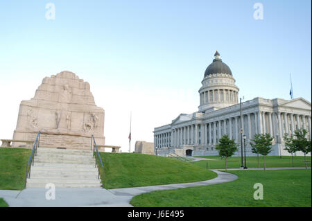 Early morning view east side of Mormon Battalion Monument, with Vanishing Race sculpture, towards Utah State Capitol - Stock Photo
