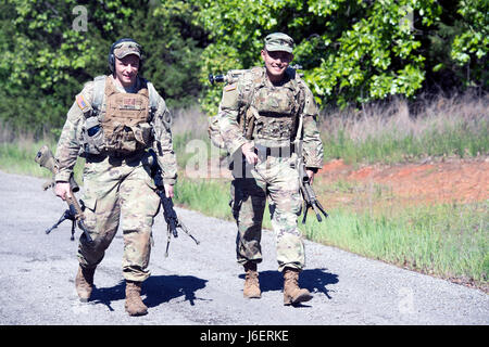 Sgt. David Peters, 2nd Squadron 101st Cavalry; and Staff Sgt. Masami Yamakado, 1st Battalion 69th Infantry, both - Stock Photo
