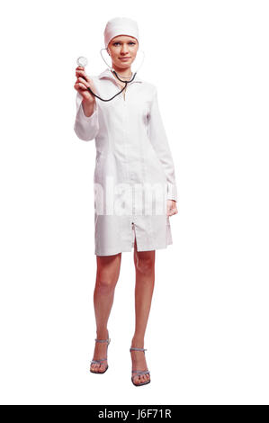 Beautiful young nurse standing isolated on white - Stock Photo