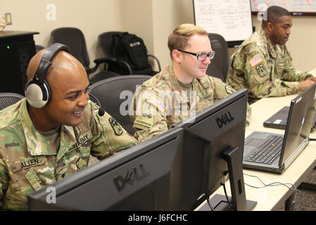 Spc. Tracy William, Sgt.Colton Cragne, and Spc. Thomas Allen with the South Carolina Army National Guard coordinates - Stock Photo