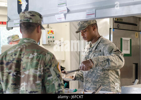 Spc. Ontroy Canty a food service specialist assigned to E Company, 6th Battalion, 101st General Support Aviation - Stock Photo
