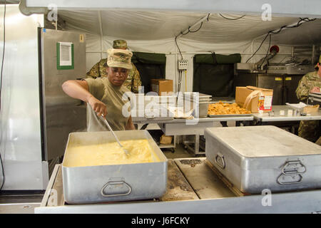 Private 1st Class Desiree Slaton, a food service specialist assigned to E Company, 6th Battalion, 101st General - Stock Photo