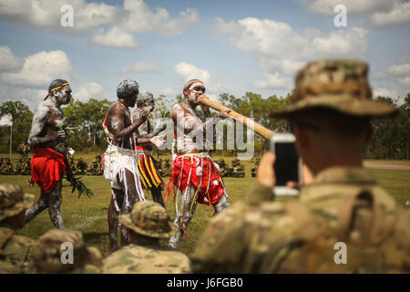AUSTRALIAN ARMY BASE ROBORTSON BARRACKS, Australia – A U.S. Army soldier records a traditional dance performed by - Stock Photo