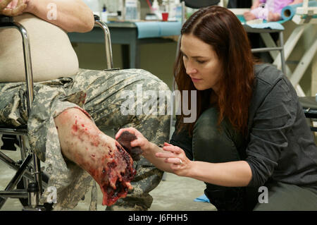 A special effects makeup artist applies latex prosthetics and fake ...