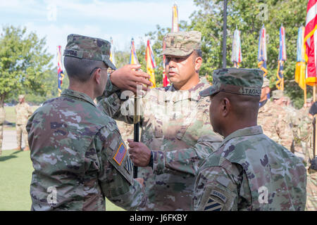 Maj. Gen. Leopoldo Quintas (left), the 3rd Infantry Division commander, passes a saber to Sgt. Maj. Steven Cisneros, - Stock Photo