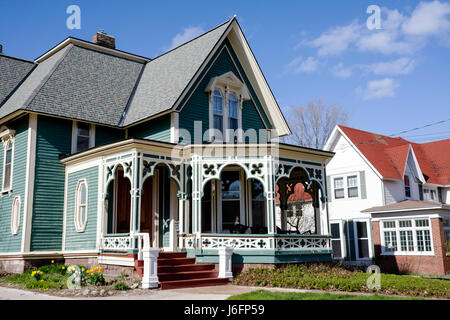 Marquette Michigan Upper Peninsula U.P. UP Lake Superior Ridge Street Victorian style house home porch gingerbread - Stock Photo